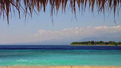 Island in turquoise sea loop Stock Video Footage