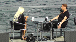 Ladies having cafe on a terrace bar Stock Video Footage