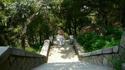 Tourists walking in mountain stone steps,Porters walking... Stock Video Footage