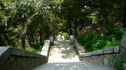 Tourists walking in mountain stone steps,Porters walking on boulevard in mountai Footage