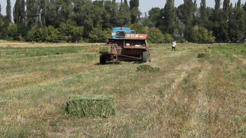 Tractor and Hay Bale Stock Video Footage