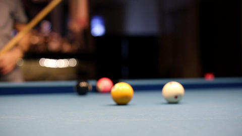 Eight-ball pool billiards player hesitates next shot Footage