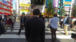 Tokyo, Japan - People crossing the street at Tokyo's Akihabara area Footage