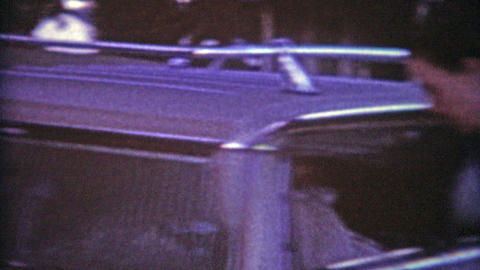 1964: Teens road trip in the family truckster rushing to leave while dad films l Footage