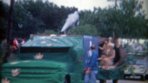 1966: Odd parade with yesterday caveman dinosaur theme Live Action