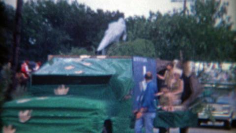 1966: Odd parade with yesterday caveman dinosaur theme Footage