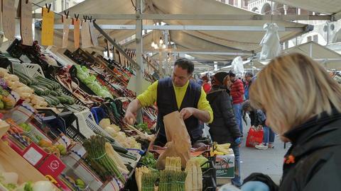 Retailing at Saturday market in Piazza delle Erbe Footage