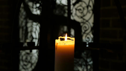 Burning candle in interere ancient castle Archivo