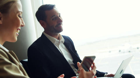Woman holding mobile phone and interacting with man Footage
