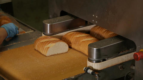 Cutting a loaf of bread into pieces and packing Footage