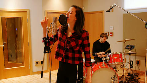 Woman singing in recording studio Live Action