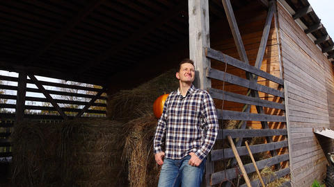 Pleased villager portrait, man stand lean to hayloft doorway and smile Footage