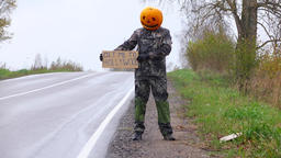 Pumpkinhead man try to hitch a ride with carton sign, Get Me To Hollywood Footage
