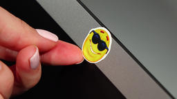 Fun sticker removed from laptop camera, webcam become open for usage Footage