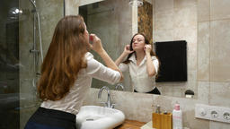 Young businesswoman get ready to go out, stand against mirror in bathroom Footage