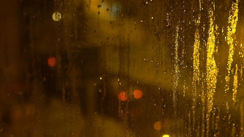 Blurred Street Lights Through Wet Glass Slow Motion Footage