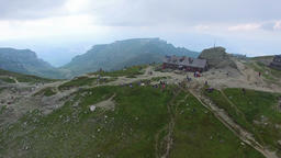Aerial view of Omu peak and chalet, Bucegi mountains, Romania Footage