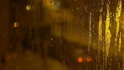 Blurred Street Lights Through Wet Glass Footage