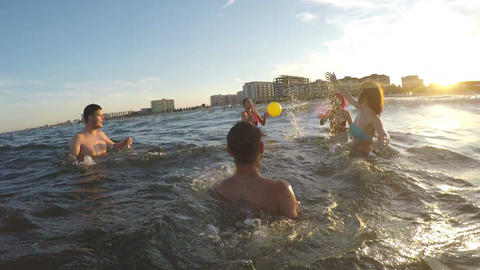 Friends having fun and playing volleyball in the sea Footage