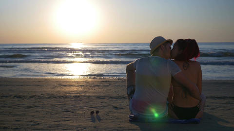Couple kissing on sandy beach at beautiful sunrise Footage