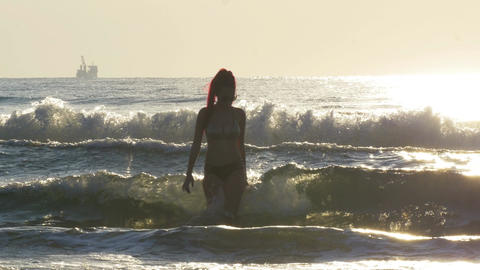 Young beautiful woman coming out of the sea Footage