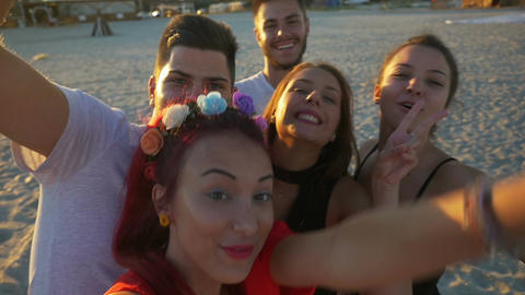 Group of friends making silly faces and fooling around on a video chat Footage