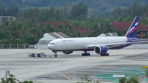 Boeing 777 of Aeroflot Airlines towing by machine Footage