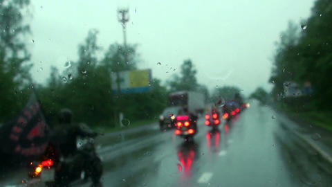 Bikers ride in the rain on the way Footage