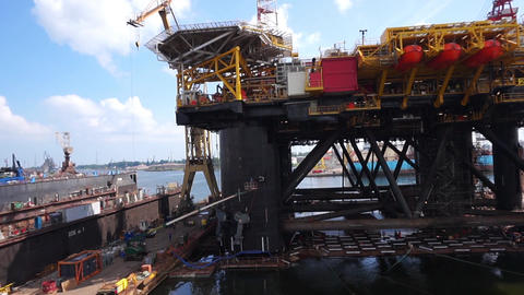 Floating production facility (oil rig platform) during renovation at shipyard Footage