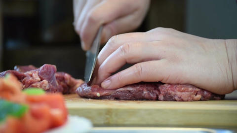 Close-up of professional chef hands slicing beef steak for Chinese stir-fry Footage