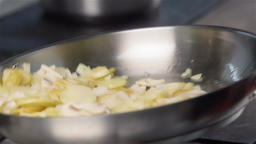 Cooking stir fried potatoes in boiling oil on pan slow motion HD video close up  画像