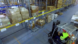 Worker loader loading goods boxes warehouse storage HD video. Forklift unload Footage
