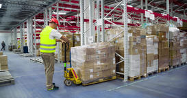 Warehouse worker transports boxes on trolley loader 4k video. Delivery unloading Footage