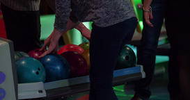 Players choose balls for bowling 4k video. Select and take balls lift returner Footage