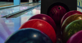 Balls returns for bowling play 4k close-up video. Lift returner, rolling alley Footage
