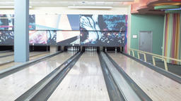 View of bowling lane HD video. Wooden alley and pin row. Ten pin game area Footage