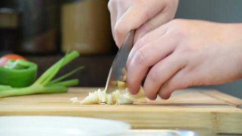 Finely Chopping Garlic For Chinese Cooking Footage