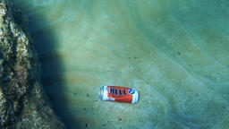 Energy drink can floating at the bottom of the sea Footage