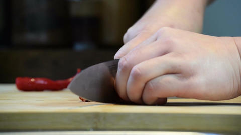 Close-up of professional chef hands using knife to finely chopping Chillies Footage