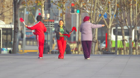 Chinese women learning to dance with fans Footage