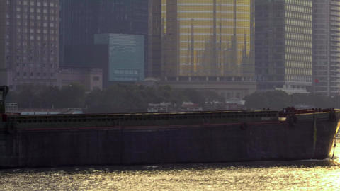 Industrial boats crossing the river in Shanghai at Sunrise Footage