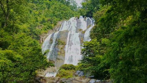Large Powerful Waterfall among Tropical Jungle Footage