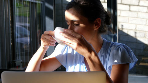 Businesswoman having a cup a cup of coffee Live Action