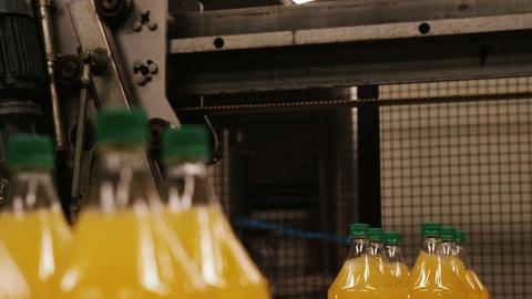Forklift loading bottles in warehouse Live Action