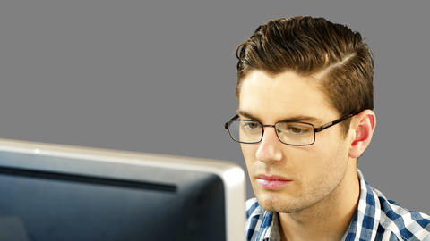 Man working on desktop Live Action