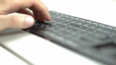 Male hand typing on keyboard Footage