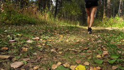 Young Woman Goes Along Path In Siberian Autumn Forest Footage
