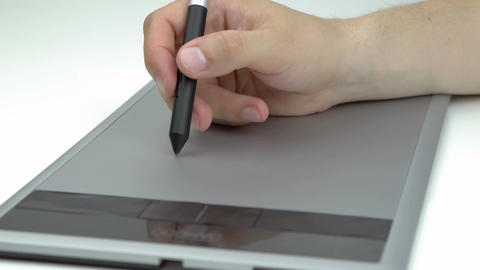 Male hand drawing on a tablet with stylus Footage