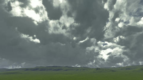Time lapse on a green meadow with gloomy clouds Animation