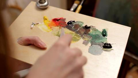 Painter artist working in her shop Footage
